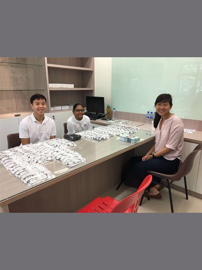Dr Agrawal's daughter and students from LKC Medicine and NUS at a local community eye screening event for spectacle frame assessment