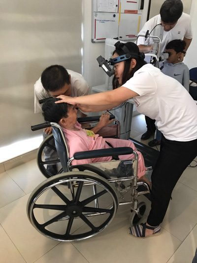 Dr Sandy assisting Dr Agrawal in a local eye screening camp at Sembawang Family Service Centre - Dr Agrawal was mentoring this project and did similar projects in Singapore