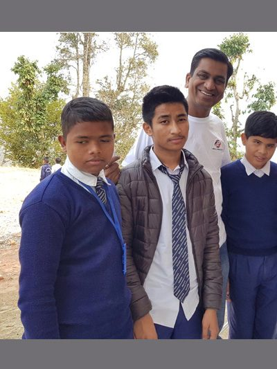 Dr Agrawal with visually impaired children in a blind school in Gorkha, Nepal